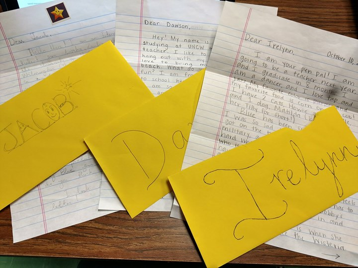 """Mrs. Ulfsax's 4th grade reading students partner with UNCW's Education Department. UNCW students read some of the same books as our students and they correspond; providing feedback to one another. The letters pictured reflect correspondence on the book entitled """"Blue."""""""