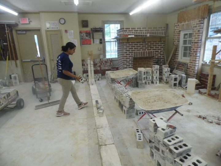 Maria Torres will attempt to lay 600 brick in one hour today! Good luck Maria!