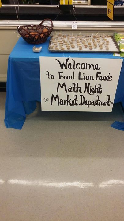 Students, parents, teachers and Food Lion staff members coll...
