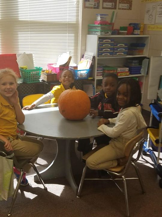Students in Ms. Michele's class learn math with pumpkins. Th...