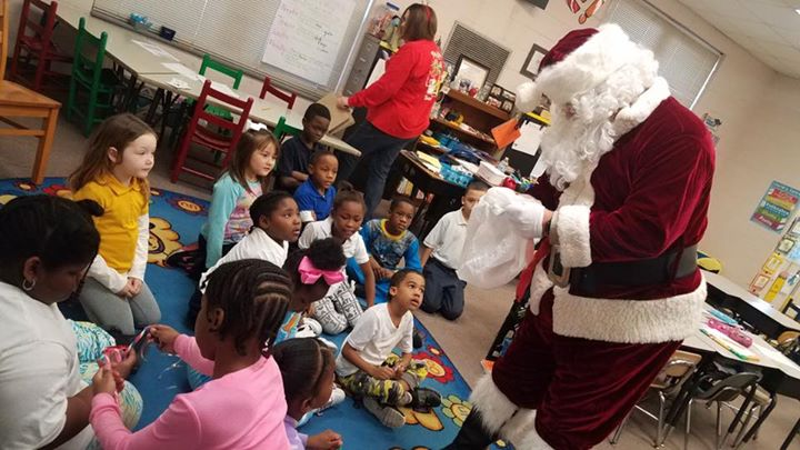 Santa Claus made a surprise stop by Mrs. Duncan's classroom ...