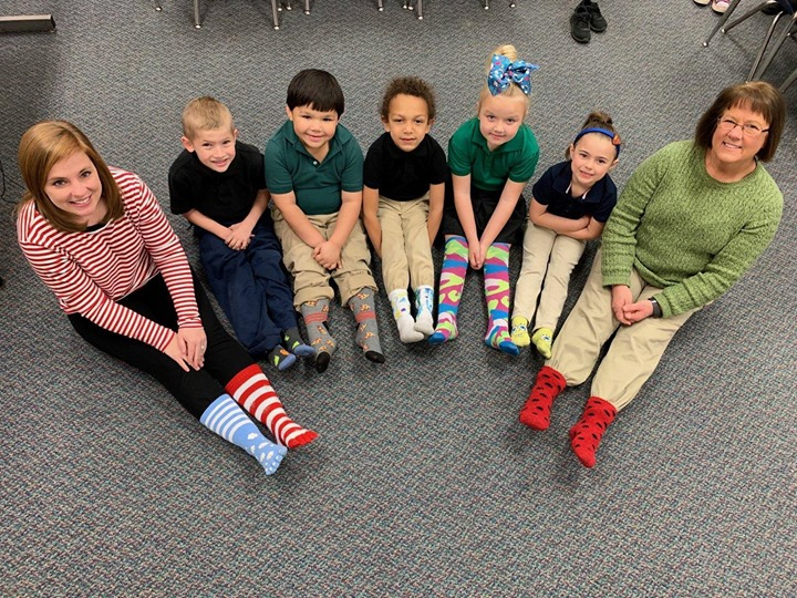 Ms. McPherson's class celebrating Read Across America week a...